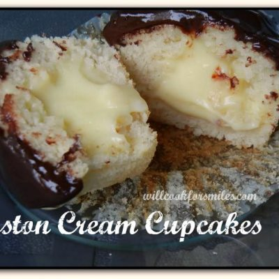 picture of 1 boston cream cupcake split in half on a glass plate
