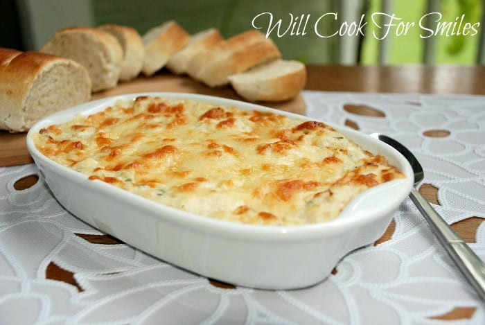 Hot Crab Dip! This creamy crab dip is made with lump crab meat, cream cheese, Parmesan cheese and baked to perfection. #dip #crabdip #appetizer #seafood #snack