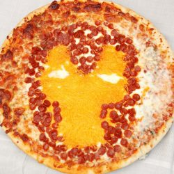 view from above of pizza with Iron Man character displayed on pizza through use of cheese and pepperoni