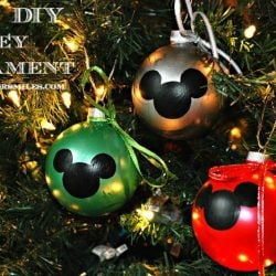 3 DIY mickey mouse ornaments on a lit christmas tree