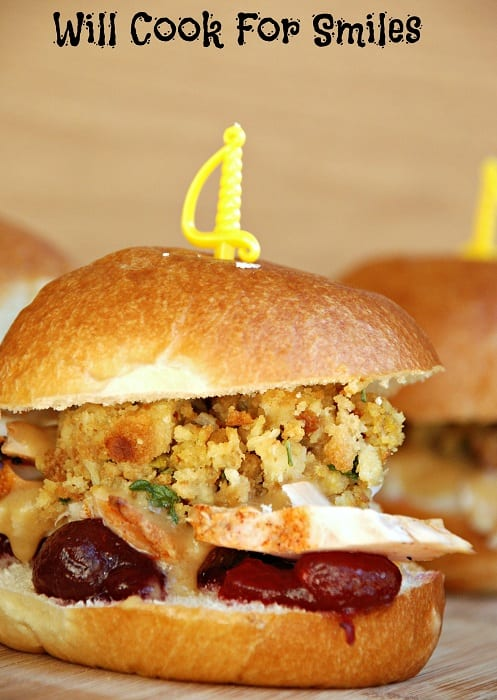 Thanksgiving Leftovers Sliders on a dinner roll with stuffing, turkey, and cranberry sauce
