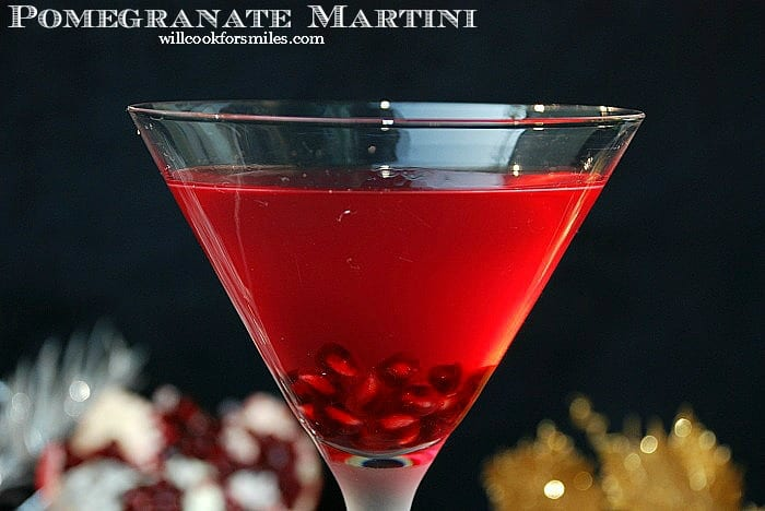 Pomegranate Martini. This sweet and tart martini is made with pomegranate liqueur, vodka, honey liqueur, and pomegranate juice. #cocktail #drink #martini #pomegranate
