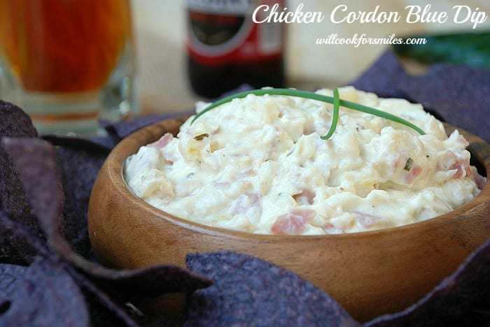 Chicken Cordon Bleu Dip Recipe in a wood bowl with purple chips around it