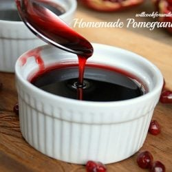 Cup of pomegrantae syrup with spoon