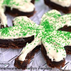 close up view of st patty's day cookies shaped as 3 leaf clovers