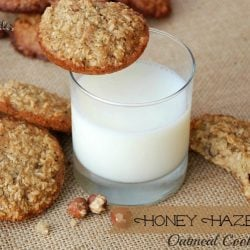 top view of cookies piled on burlap cloth with glass of milk in center of shot