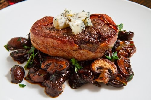Double Smoked Bacon Wrapped Fillet Mignon with Caramelized Mushrooms in a Red Wine Sauce topped with Blue Cheese 500