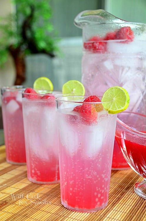 This refreshing Raspberry Key Lime Italian Soda is homemade and very easy. Made with fresh raspberry-lime syrup and soda water, this is the favorite drink to serve with summer fun outside. #drink #summer #italiansoda #homemade #raspberry #keylime