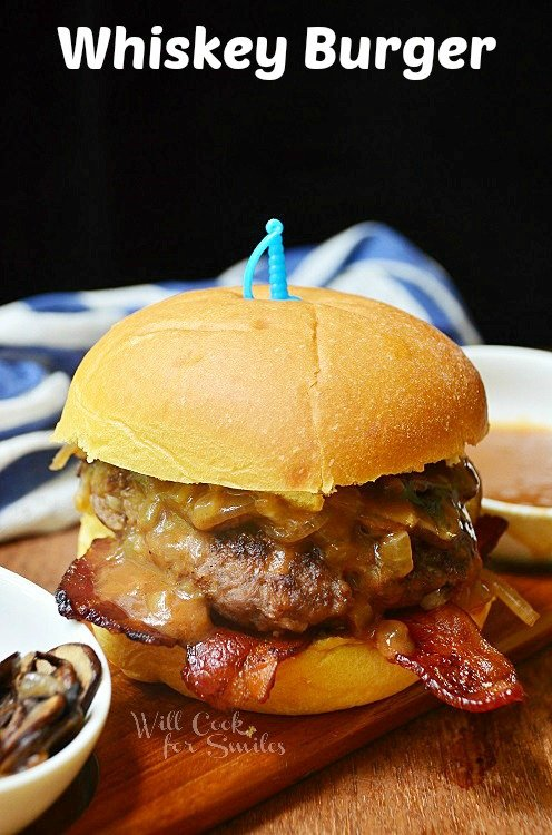 whiskey burger with bacon and cheese on a bun