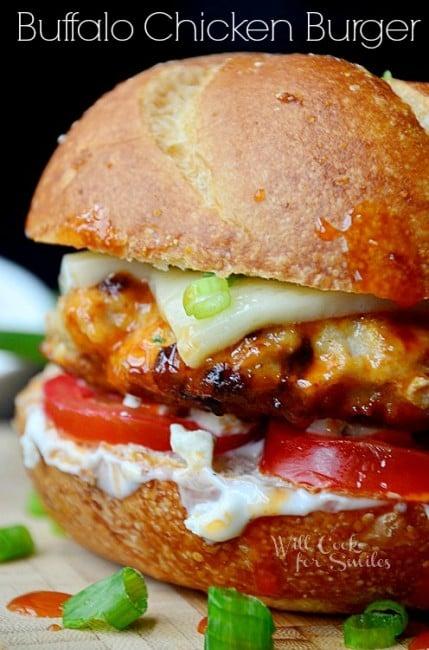 buffalo chicken burger with cheese, ranch, and tomato on a hamburger bun
