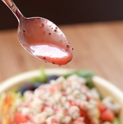 Strawberry-Lime-Poppy-Seed-Vinaigrette-dripping-on-salad