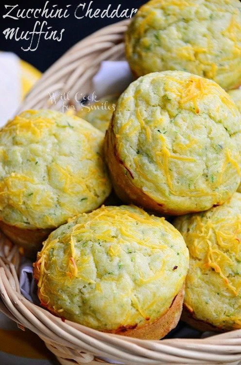 Savory Cheddar Zucchini Muffins. Soft, moist and flavorful muffins made with fresh zucchini and extra sharp cheddar for full flavor. #zucchinirecipe #zucchini #muffins #savorymuffins