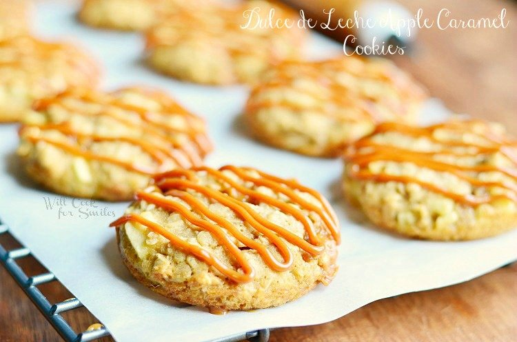 Dulce de Leche Apple Caramel Oatmeal Cookies. Wonderful fall homemade cookie recipe. These are soft oatmeal cookies made with apples, chewy caramel chunks, and drizzled withn Dulce de Leche. #homemade #cookies #applecaramel #apple #oatmeal #caramel