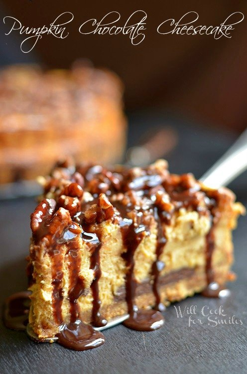 Pumpkin Chocolate Cheesecake Recipe. This homemade pumpkin cheesecake recipe is amazing. A smooth pumpkin cheesecake made with Hershey's chocolate bar on the bottom, topped with pecans, and more chocolate syrup on top. #pumpkin #cheesecake #chocolate #homemade #pumpkindesserts