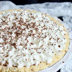 white baking pan with french silk pie as a white decorative napkin surround baking dish