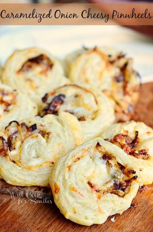 Caramelized Onion Cheesy Pinwheels on a cutting board