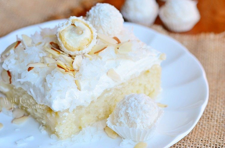 Raffaello Poke Cake Coconut Cake with White ChocolateCoconut Cream and Whipped Topping 4  from willcookforsmiles.com #cake #coconut #pokecake