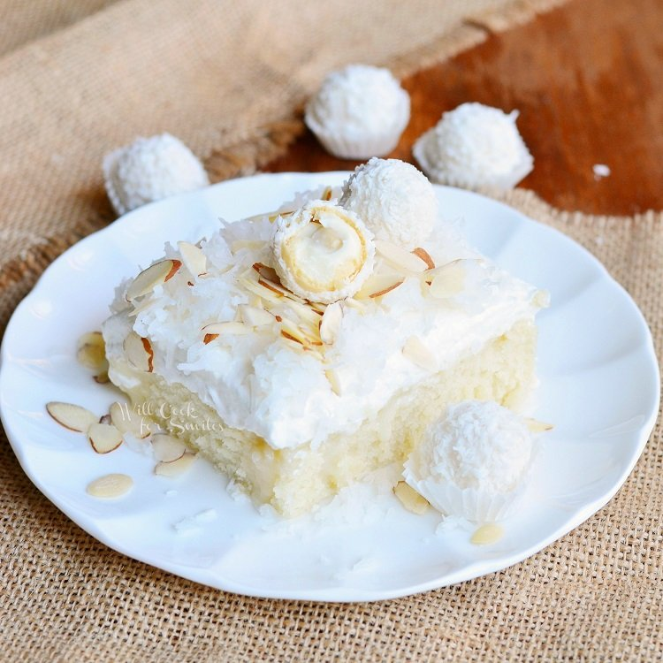 Raffaello Poke Cake Coconut Cake with White ChocolateCoconut Cream and Whipped Topping | from willcookforsmiles.com #cake #coconut #pokecake
