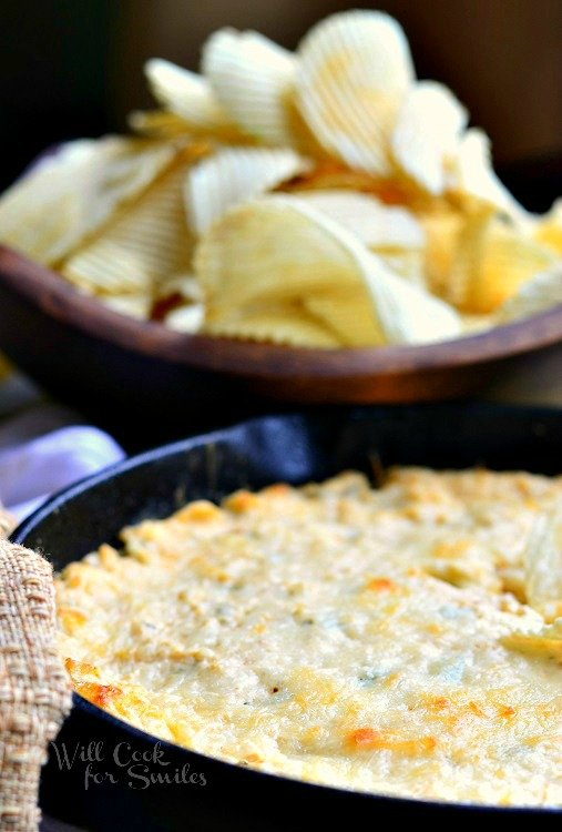 This Spicy Chicken Ranch Dip baked in a skillet and packed with juicy chicken, cheese, green onions, cream cheeses, and Hidden Valley Spicy Ranch mix.  #dip #chickendip #ranch #ranchdip #spicydip