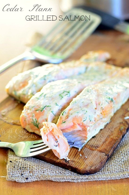Cedar Plank Salmon smothered in creamy lemon dill sauce for you to grill this summer! | willcookforsmiles.com