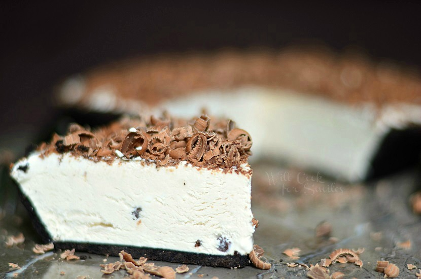 Mocha Ice Cream Pie, a cream pie made with iced coffee, mini chocolate morsels, topped with shaved milk chocolate and it's frozen! from willcookforsmiles.com