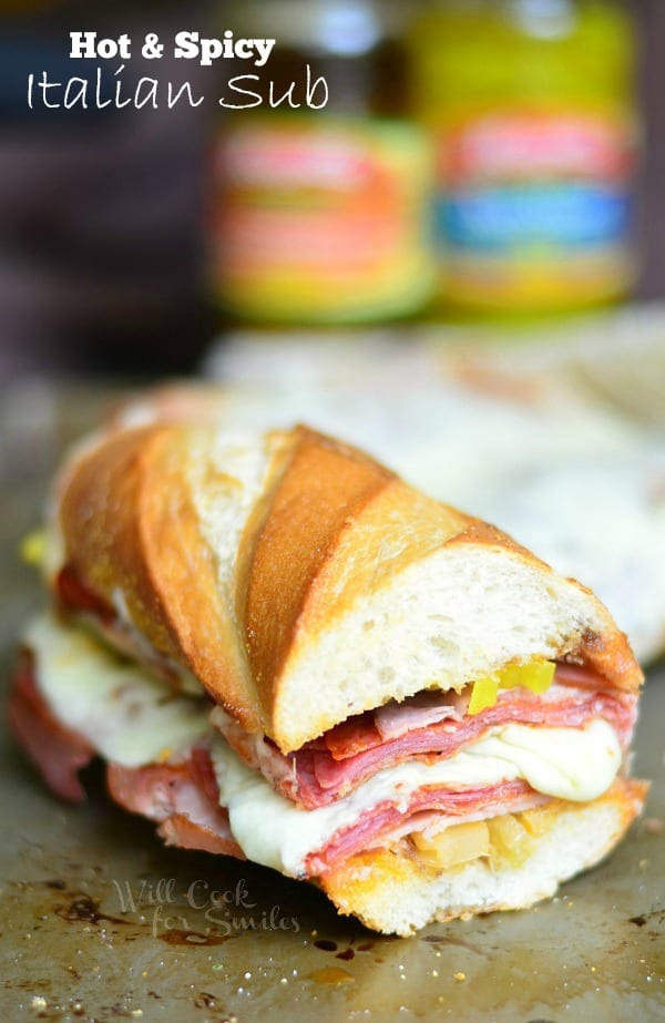 Spicy Baked Italian Sub. Made with all the great Italian flavors like capicola ham, smoked ham, salami, pepperoni, Fontina cheese, banana peppers and hot Italian Sandwich Mix. #sandwich #sub #italian #spicy #ham