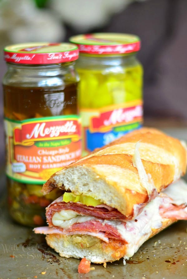 Italian Sub Sandwich. Made with all the great Italian flavors like capicola ham, smoked ham, salami, pepperoni, Fontina cheese, banana peppers and hot Italian Sandwich Mix. #sandwich #sub #italian #spicy #ham