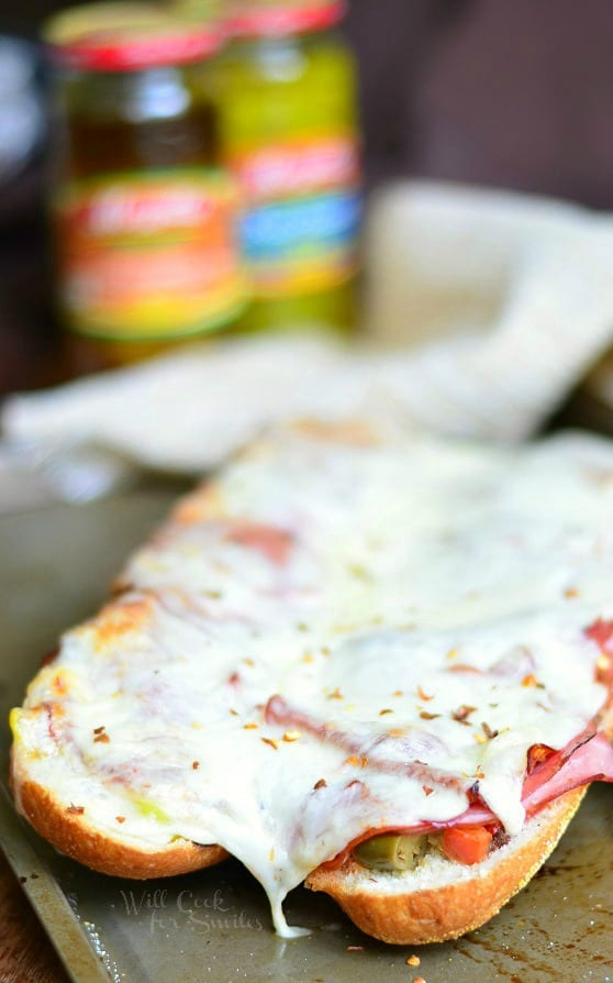 Baked Italian Sub. Made with all the great Italian flavors like capicola ham, smoked ham, salami, pepperoni, Fontina cheese, banana peppers and hot Italian Sandwich Mix. #sandwich #sub #italian #spicy #ham