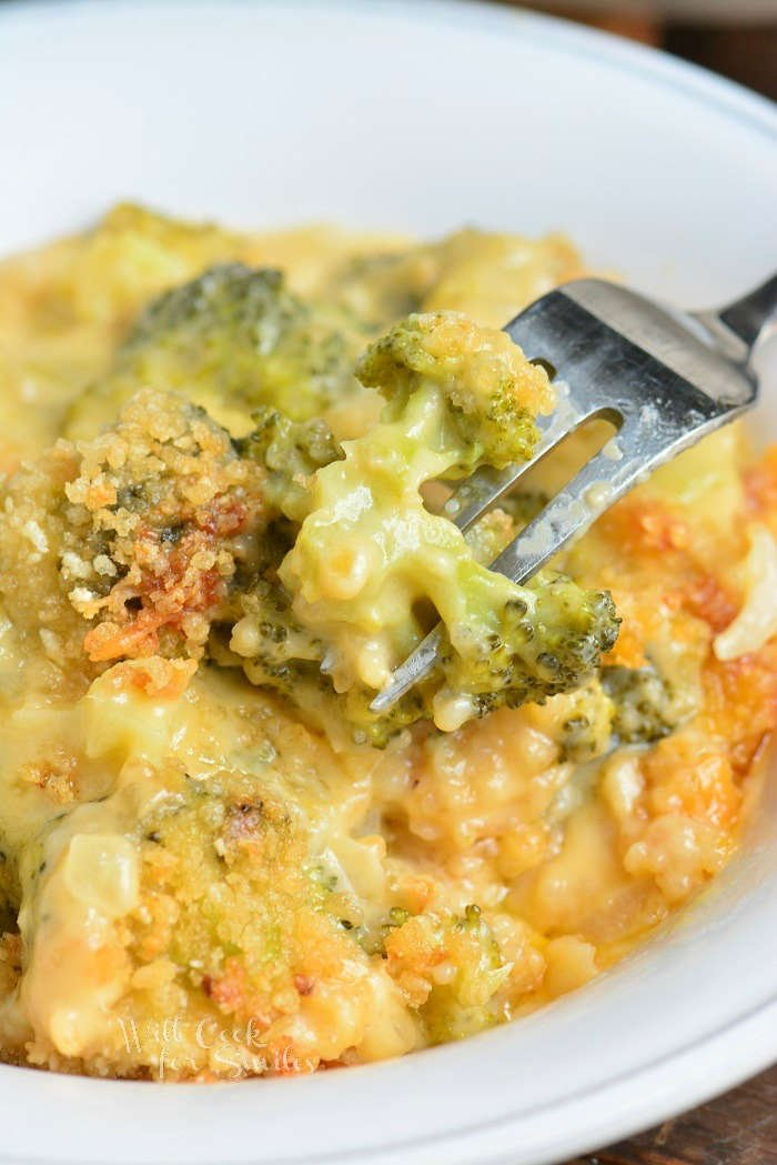 broccoli casserole in a bowl with a fork