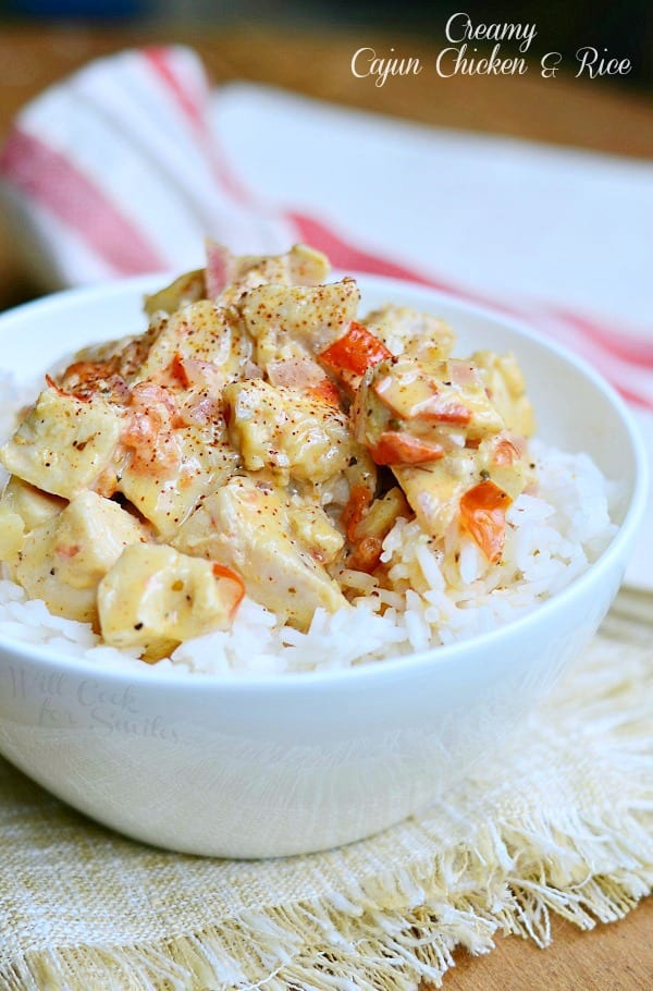 Creamy Cajun Chicken & Rice with diced red peppers in a white bowl