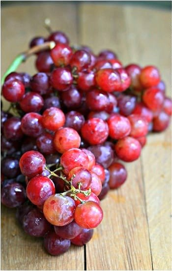 red grapes on a wood table