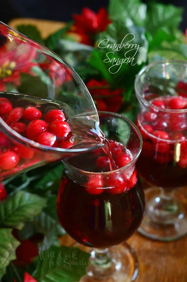 Cranberry Sangria. Delicious holiday cocktail made with fresh cranberries, cranberry flavored vodka, juice and red wine. #sangria #cranberry #holidaydrink #cranberrysangria