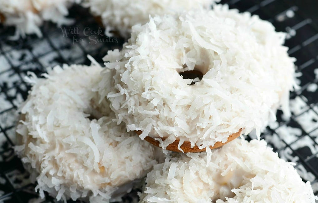 Coconut Cake Donuts. Soft, cake-like baked coconut donuts infused with coconut flavors inside, glazed in coconut icing, and dipped into sweetened coconut flakes. #donuts #doughnuts #coconut #dessert #breakfast #brunch