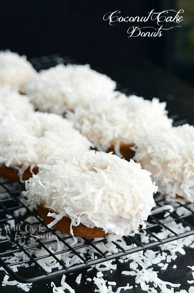 Coconut Baked Donuts. Soft, cake-like baked coconut donuts infused with coconut flavors inside, glazed in coconut icing, and dipped into sweetened coconut flakes.