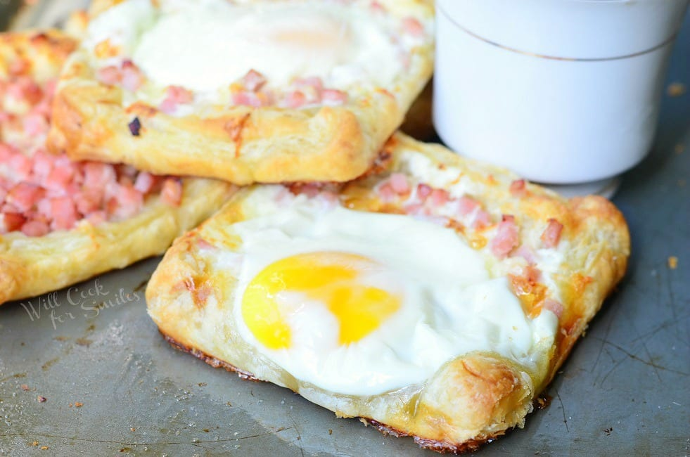 Ham, Egg & Cheese Breakfast Pastry on a baking dish with a cup of coffee