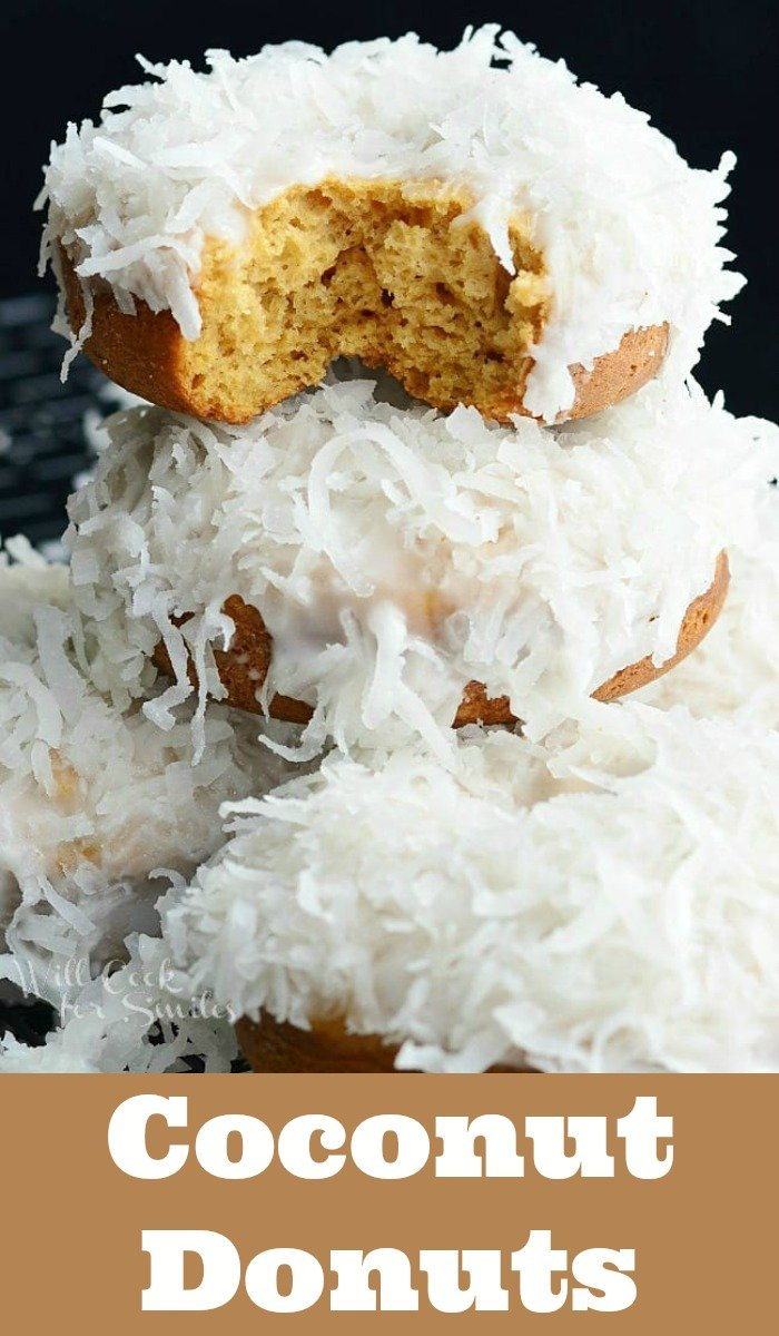 Baked Coconut Donuts. Soft, cake-like baked coconut donuts infused with coconut flavors inside, glazed in coconut icing, and dipped into sweetened coconut flakes. #donuts #doughnuts #coconut #dessert #breakfast #brunch