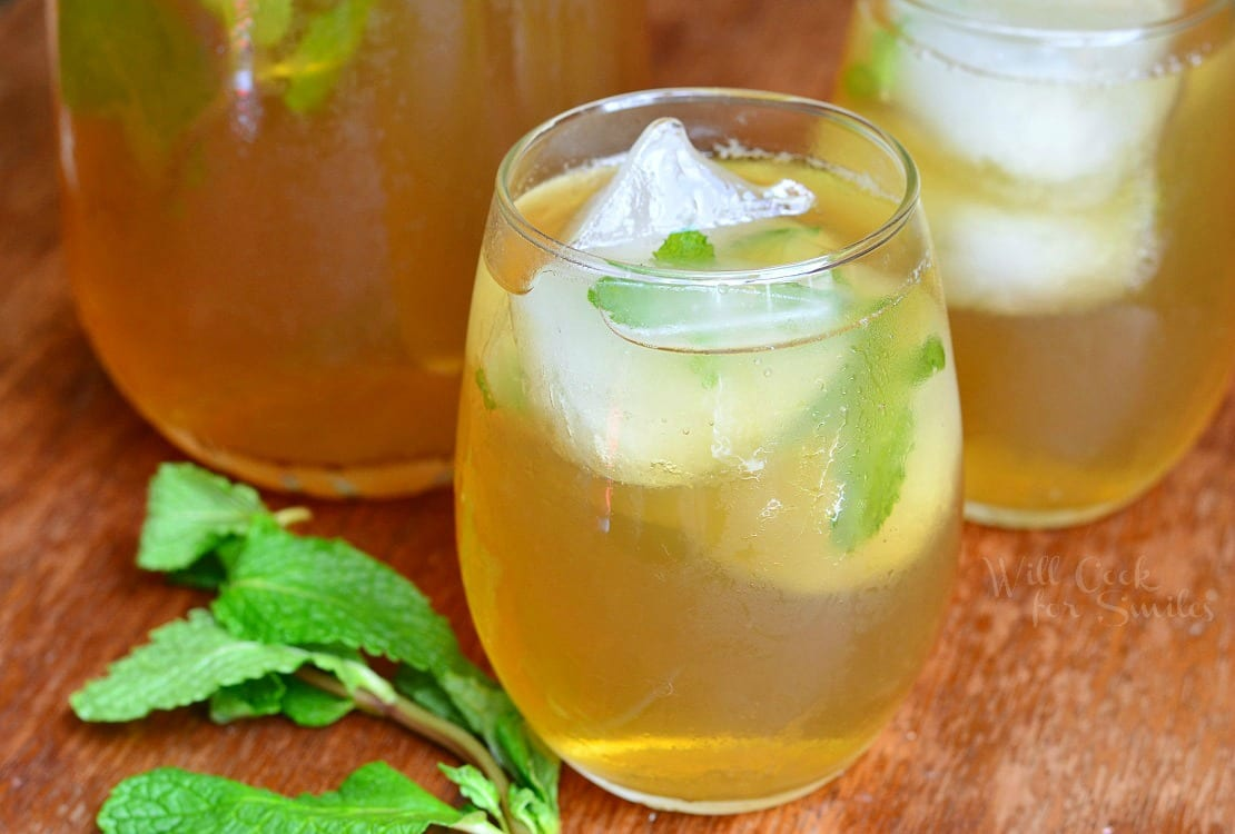 Honey Mint Green Iced Tea in a glass with ice and mint in the glass