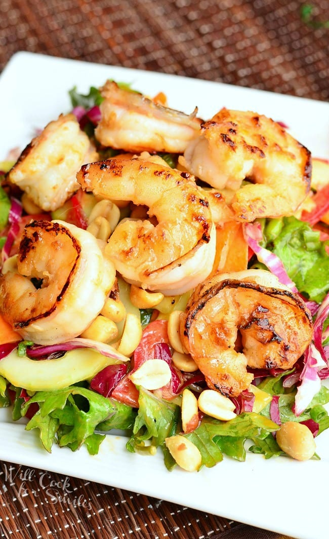 Thai Shrimp Salad with Peanut Dressing. It's made with juicy, seared shrimp flavored with honey, garlic and ginger, on top of a vegetable mixture dressed with easy, homemade peanut dressing.  from willcookforsmiles.com