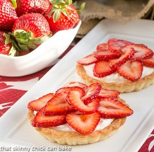 Strawberry tarts with fresh strawberries on top