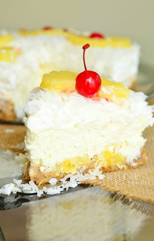 Pina Colada Cheesecake. Out-of-this-world tropical cheesecake! Smooth, creamy cheesecake that tastes like piña colada. \ from willcookforsmiles.com