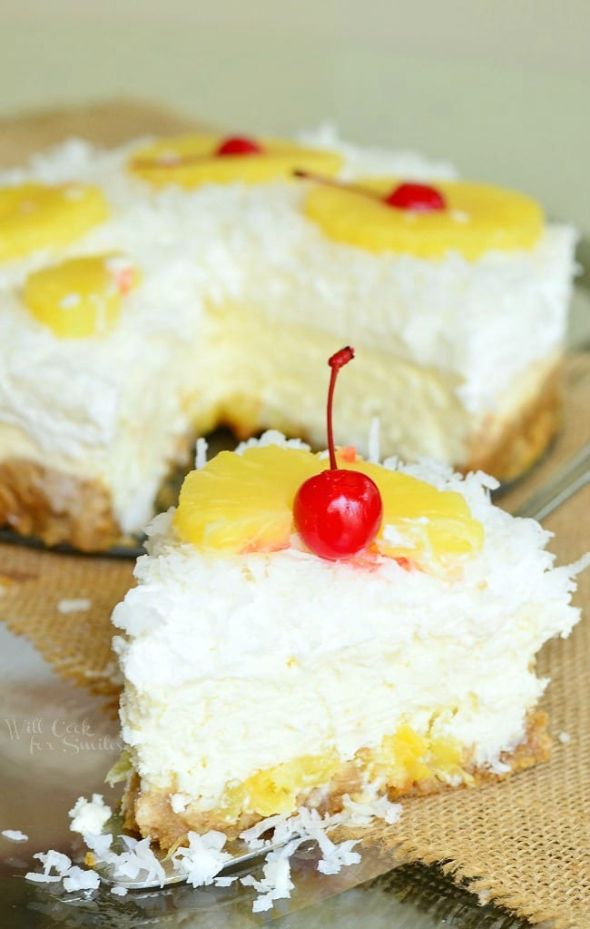 pina Colada Cheesecake with coconut, cherry, and pineapple