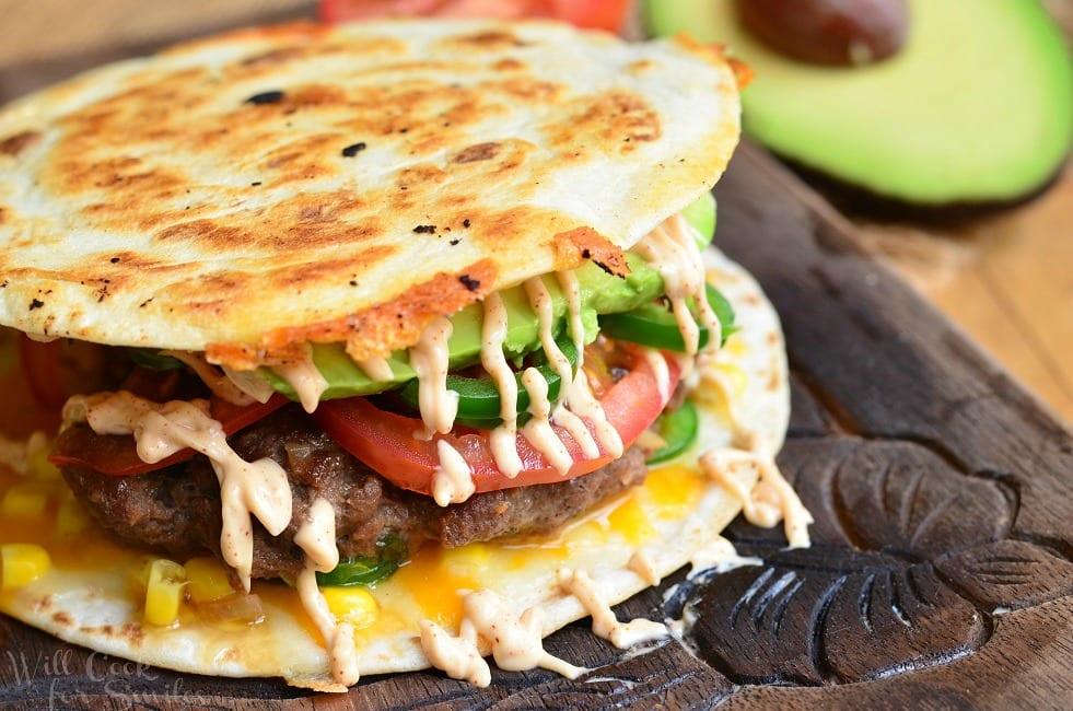 Quesadilla Burger with avocado tomato and fried tortilla as the bun