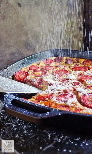 strawberry clafoutis in a cast iron pan