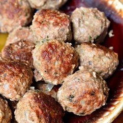 brown bowl filled with meatballs used for meatball subs