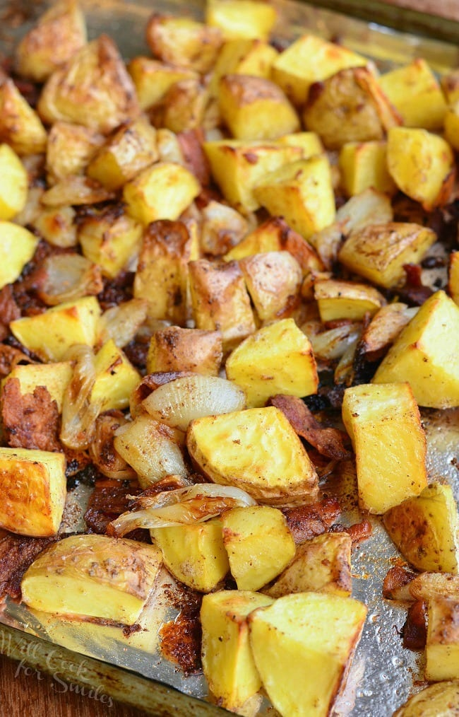 Roasted Potatoes with Bacon and Pearl Onions on a baking sheet