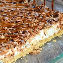 Glass baking dish filled with no bake samoas cheesecake bars