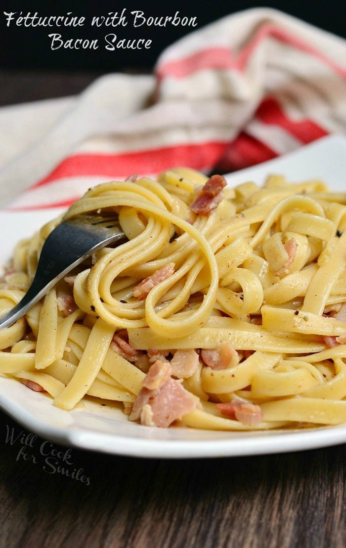 Fettuccine with Bourbon Bacon Sauce on a plate with a fork