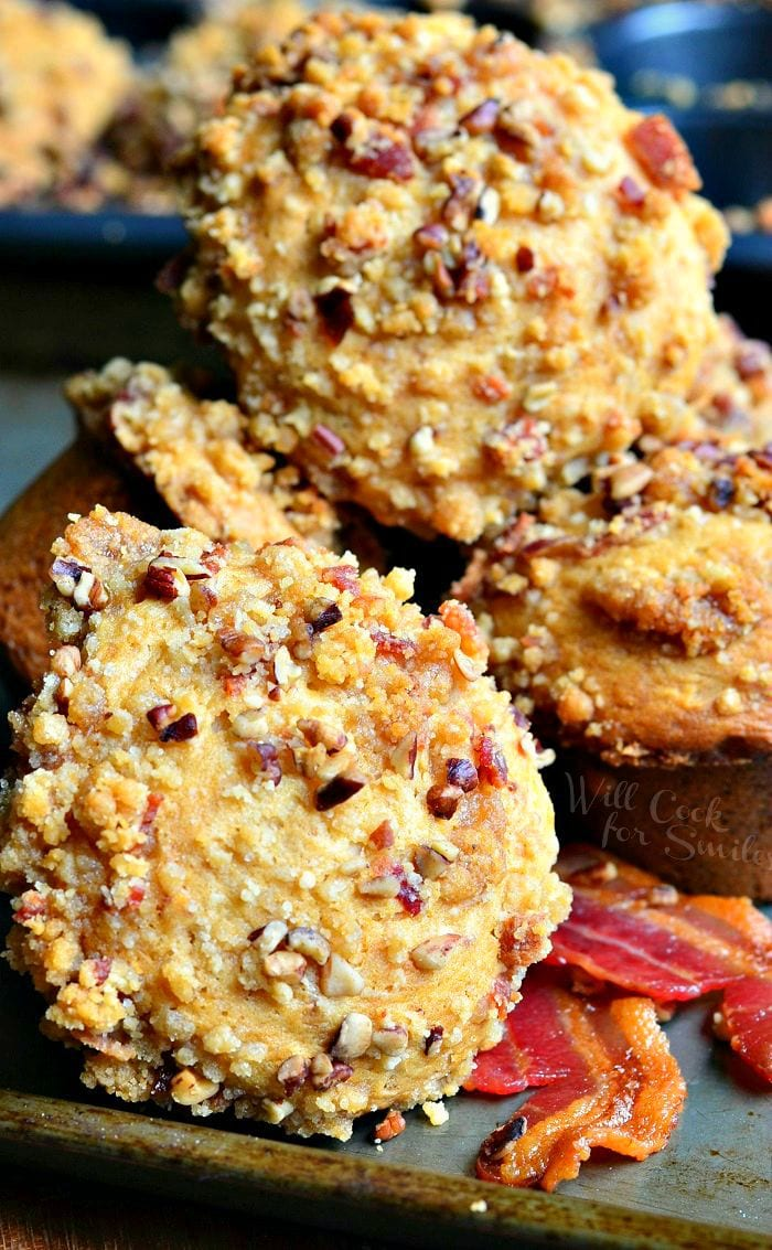 Maple Bacon Streusel Muffins stacked up with bacon around it