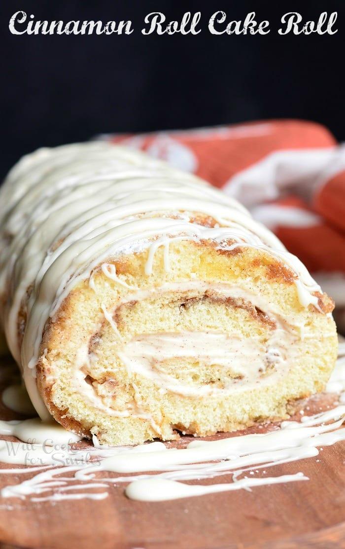 Cinnamon Roll Cake Roll on a cutting board