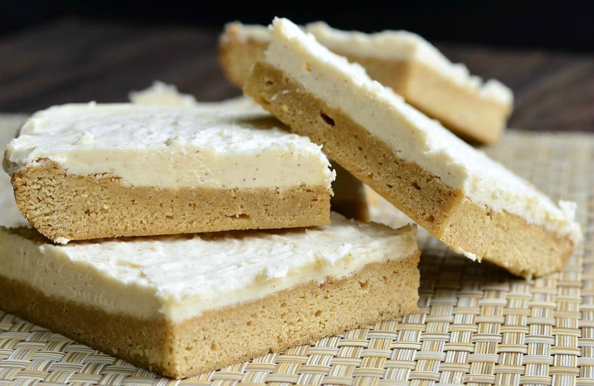 Frosted Maple Cookie Bars stacked up on placemat